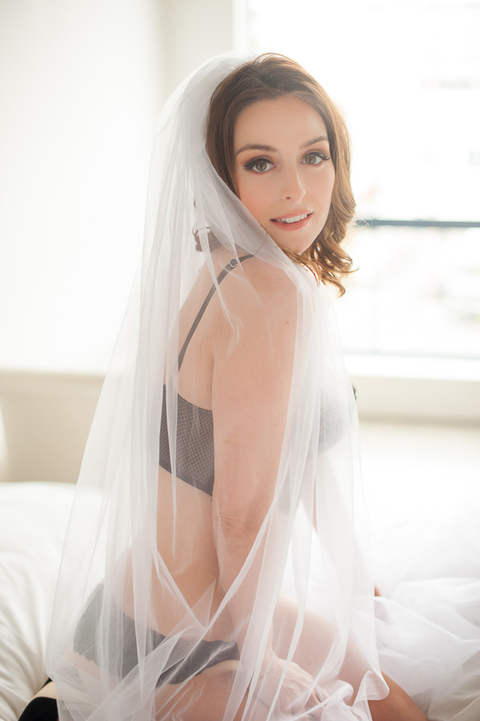 woman in bed with bridal veil
