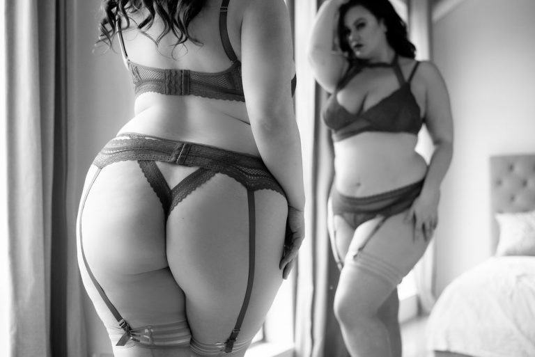 woman standing in front of mirror with lingerie photographed by vancouver boudoir photographer Lux Portrait