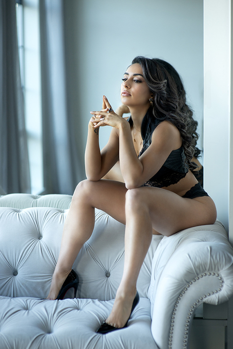 woman sitting on top of couch, lux boudoir